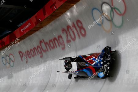 Jamie Greubel Poser and Aja Evans of the United States speed through the track during the women's bobsled training run at the 2018 Winter Olympics in Pyeongchang, South Korea
