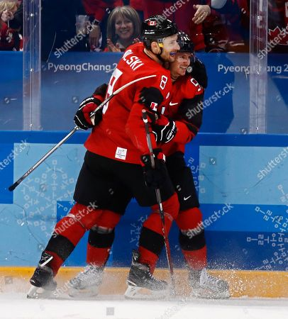 Christian Thomas (R) of Canada celebrates a goal with teammate Wojtek Wolski (L) against Korea during the men's preliminary round inside the Gangneung Hockey Centre at the PyeongChang Winter Olympic Games 2018, in Gangneung, South Korea, 18 February 2018. The PyeongChang 2018 Winter Olympic Games, will run from 09 to 25 February 2018.