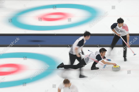 Team South Korea's Se Hyeon Seong (C), Ki Bok Lee (R) and Eun Su Oh (L) in action during the Men's Curling Round Robin match between South Korea and Denmark at the Gangneung Curling Centre, in Gangneung, during the PyeongChang Winter Olympic Games 2018, South Korea, 18 February 2018.