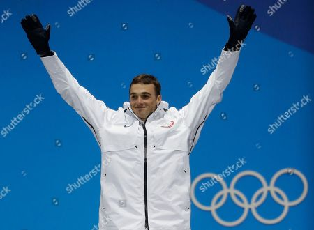 Silver medalist in the men's slopestyle Nick Goepper, of the United States, poses during the medals ceremony at the 2018 Winter Olympics in Pyeongchang, South Korea