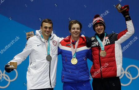 Medalists in the men's slopestyle, from left, United States' Nick Goepper, silver, Norway's Oystein Braaten, gold, and Canada's Alex Beaulieu-Marchand, bronze, pose during their medals ceremony at the 2018 Winter Olympics in Pyeongchang, South Korea