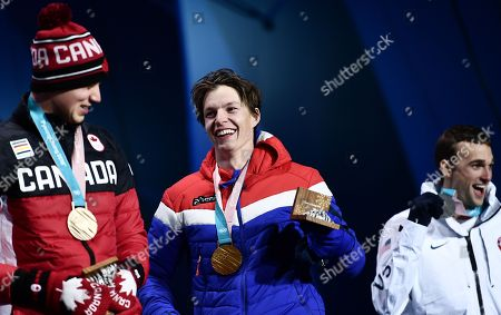 (from right) Silver medalist Nick Goepper of the USA, gold medalist Oystein Braaten of Norway and bronze winner Alex Beaulieu-Marchand of Canada during the medal ceremony for the men's Slopestyle Freestyle Skiing event at the PyeongChang 2018 Olympic Games, South Korea, 18 February 2018.