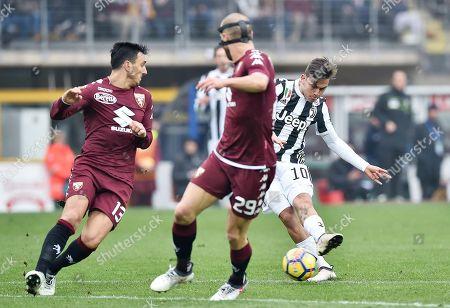 Torino's Nicolas Burdisso (L) and Juventus's Paulo Dybala (R) in action during the Italian Serie A soccer match Torino FC vs Juventus FC at Olimpico Stadium in Turin, Italy, 18 February 2018.