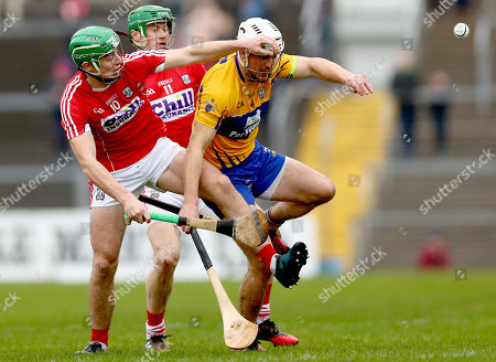 Clare vs Cork. Cork's Robbie O Flynn and Seamus Harnedy with Patrick O?Connor of Clare