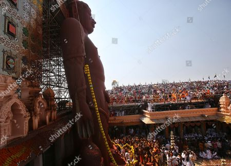Devotees watch the anointment ceremony of the 58.8-foot monolithic statue of Jain god Gomateshwara at Shravanabelagola 145 kilometers (91 miles) west of Bangalore, India, . Hundreds of thousands of Jain devotees will attend the Mahamastabhisheka or head anointing ceremony of the 1,037-year-old statue Gomateswara (Lord Bahubali), a tradition held every 12 years since AD 981. The 1,037-year-old statue is bathed with milk, turmeric, vermilion, saffron, sandalwood paste, powder of medicinal herbs and gold coins