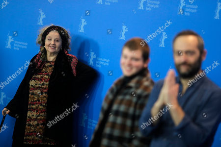Actress Hanna Schygulla, left, looks to actor Anthony Bajon, center, and director Cedric Kahn, right, as they pose at a photo-call for the film 'The Prayer' during the 68th edition of the International Film Festival Berlin, Berlinale, in Berlin, Germany