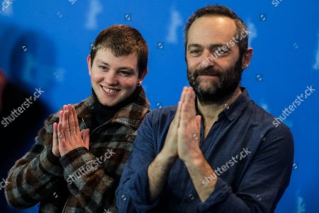 Actor Anthony Bajon, left, and director Cedric Kahn, right, pose at a photo-call for the film 'The Prayer' during the 68th edition of the International Film Festival Berlin, Berlinale, in Berlin, Germany
