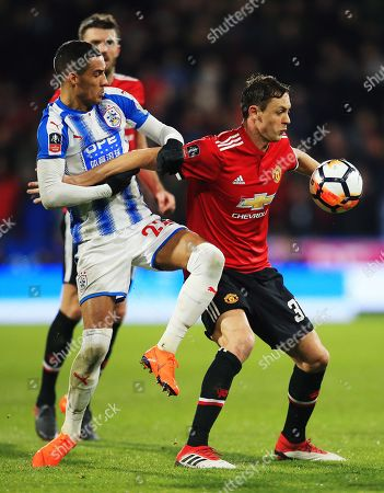 Nemanja Matic of Manchester United and Collin Quaner of Huddersfield Town
