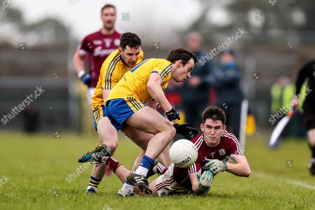 Stock Photo of Roscommon vs Galway. Galway's Barry McHugh with Niall Kilroy and Ciaran Murtagh of Roscommon