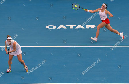 Gabriela Dabrowski (L) of Canada and Jeļena Ostapenko (R) of Latvia in action during their doubles final match against Maria Jose Martinez Sanchez  of Spain and Andreja Klepac of Slovenia at the WTA Qatar Ladies Open tennis tournament in Doha, Qatar, 18 February 2018.