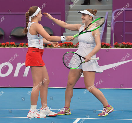 Gabriela Dabrowski (R) of Canada and Jeļena Ostapenko (L) of Latvia celebrate winning the doubles final match against against Maria Jose Martinez Sanchez of Spain and Andreja Klepac of Slovenia at the WTA Qatar Ladies Open tennis tournament in Doha, Qatar, 18 February 2018.