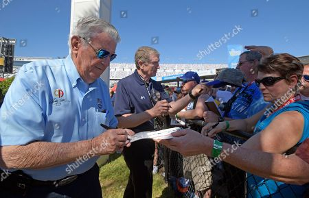 Stock Photo of Bobby Allison, Bill Elliott. Bobby Allison, left, and Bill Elliott, back, sign autographs before the NASCAR Daytona 500 Cup series auto race at Daytona International Speedway in Daytona Beach, Fla