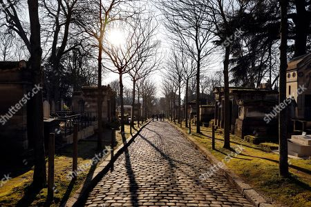 Visitors walk among the graves of the Pere Lachaise cemetery in Paris, France, 18 February 2018. The Cemetery of 45 hectares and around 70000 plots is the most famous necropolis in France and the most visited by tourists with more than three millions visitors per year. Honore de Balzac, Oscar Wilde, Maria Callas, Frederic Chopin, Marcel Proust, Jim Morrison and many other famous artists were burried in this cemetery.