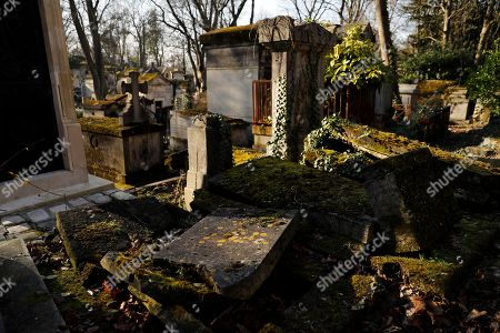 Broken graves are left open in the old part of the Pere Lachaise cemetery in Paris, France, 18 February 2018. The Cemetery of 45 hectares and around 70000 plots is the most famous necropolis in France and the most visited by tourists with more than three millions visitors per year. Honore de Balzac, Oscar Wilde, Maria Callas, Frederic Chopin, Marcel Proust, Jim Morrison and many other famous artists were burried in this cemetery.