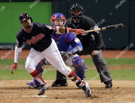 Cleveland Indians' Rajai Davis hits a two run home run against the Chicago Cubs during the eighth inning of Game 7 of the Major League Baseball World Series in Cleveland. The Cleveland Indians have signed free agent Davis to a minor league contract, bringing back the speedy outfielder who hit one of the biggest home runs in team history