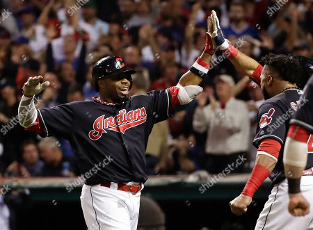 Cleveland Indians' Rajai Davis celebrates after his two run home run against the Chicago Cubs during the eighth inning of Game 7 of the Major League Baseball World Series in Cleveland. The Indians have signed free agent Davis to a minor league contract, bringing back the speedy outfielder who hit one of the biggest home runs in team history