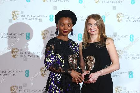 Rungano Nyoni, Emily Morgan. Rungano Nyoni, left, and Emily Morgan pose with their Outstanding Debut awards backstage at the BAFTA 2018 Awards in London
