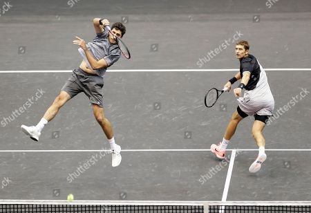 Stock Picture of Philipp Oswald, Max Mirnyi. Philipp Oswald, of Austria, left, returns the ball as Max Mirnyi, of Belarus, looks on during their finals double match at the New York Open tennis tournament in Uniondale, N.Y., . Oswald and Mirnyi won the match against Wesley Koolhof, of the Netherlands, and Artem Sitak, of New Zealand
