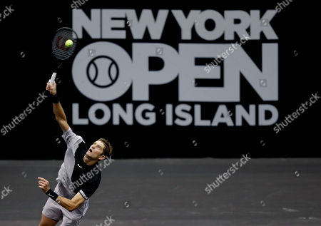 Max Mirnyi, of Belarus, serves during his finals double match at the New York Open tennis tournament in Uniondale, N.Y., . Mirnyi and Philipp Oswald, of Austria, won the match against Wesley Koolhof, of the Netherlands, and Artem Sitak, of New Zealand