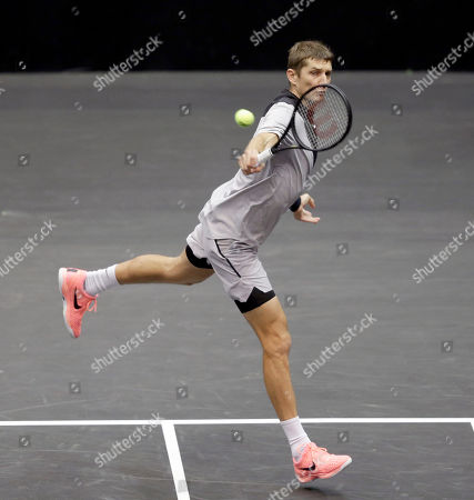 Stock Image of Max Mirnyi, of Belarus, returns a shot during his finals double match at the New York Open tennis tournament in Uniondale, N.Y., . Mirnyi and Philipp Oswald, of Austria, won the match against Wesley Koolhof, of the Netherlands, and Artem Sitak, of New Zealand