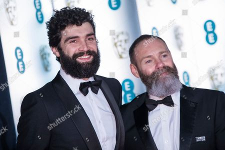 Alec Secareanu, Francis Lee. Alec Secareanu and Francis Lee pose for photographers upon arrival at the BAFTA Film Awards after-party, in London