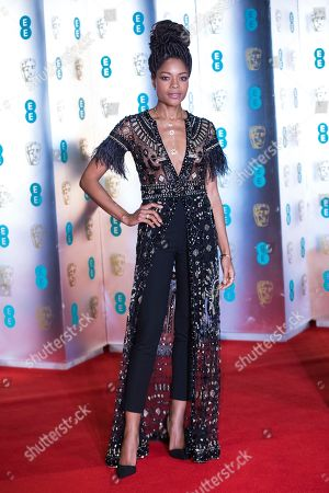 Naomi Harris poses for photographers upon arrival at the BAFTA Film Awards after-party, in London