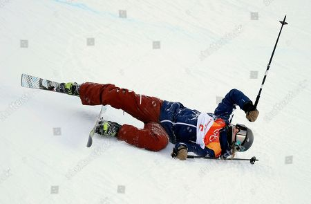 Devin Logan, of the United States, crashes during the women's halfpipe qualifying at Phoenix Snow Park at the 2018 Winter Olympics in Pyeongchang, South Korea
