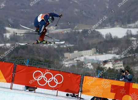 Devin Logan, of the United States, jumps during women's halfpipe qualifying at Phoenix Snow Park at the 2018 Winter Olympics in Pyeongchang, South Korea