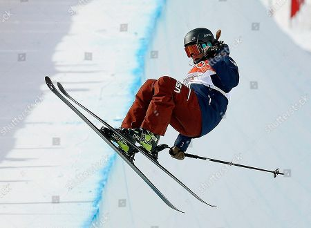 Devin Logan, of the United States, jumps during the women's halfpipe qualifying at Phoenix Snow Park at the 2018 Winter Olympics in Pyeongchang, South Korea