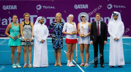 Jelena Ostapenko of Latvia, Gabriela Dabrowski of Canada, Maria Jose Martinez Sanchez of Spain & Andreja Klepac of Slovenia pose with their trophies after the doubles final
