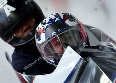 Driver Jamie Greubel Poser and Aja Evans of the United States arrive at the finish area during a training run for the women's bobsled competition at the 2018 Winter Olympics in Pyeongchang, South Korea