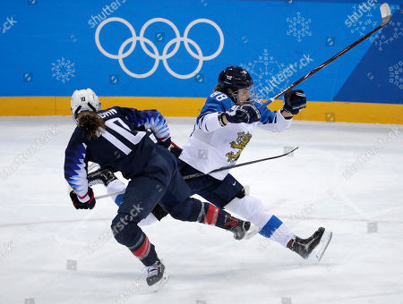 Meghan Duggan (10), of the United States, and Ronja Savolainen, of Finland, collide during the first period of the semifinal round of the women's hockey game at the 2018 Winter Olympics in Gangneung, South Korea