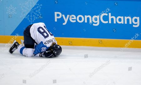 Ronja Savolainen, of Finland, grimaces in pain after colliding with Meghan Duggan, of the United States, during the first period of the semifinal round of the women's hockey game at the 2018 Winter Olympics in Gangneung, South Korea