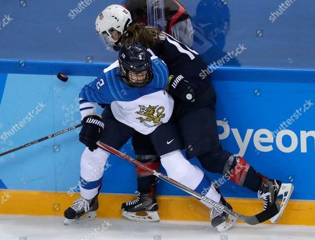 Isa Rahunen (2), of Finland, checks Meghan Duggan (10), of the United States, as they battle for the puck during the third period of the semifinal round of the women's hockey game at the 2018 Winter Olympics in Gangneung, South Korea