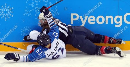 Tanja Niskanen (L) of Finland and Meghan Duggan (R) of USA  during the Women's Ice Hockey Semifinal match between USA and Finland at the Gangneung Hockey Centre during the PyeongChang Winter Olympic Games 2018, in Gangneung, South Korea, 19 February 2018.