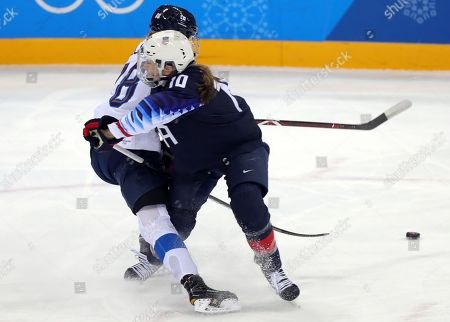 Ronja Savolainen (L) of Finland and Meghan Duggan (R) of USA in action during the Women's Ice Hockey Semifinal match between USA and Finland at the Gangneung Hockey Centre during the PyeongChang Winter Olympic Games 2018, in Gangneung, South Korea, 19 February 2018.
