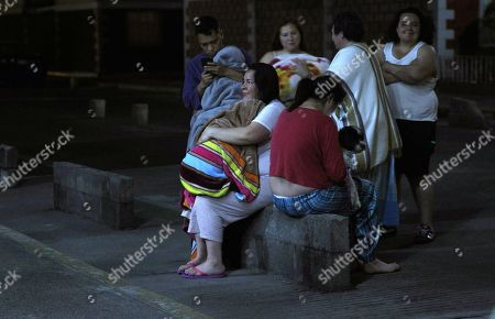 People wait outside their houses after being evacuated due to an earthquake in Mexico City, Mexico, 19 February 2018. A 5.9 magnitude earthquake shook Oxaca, southern Mexico today at 00:57 pm local time (6:57GMT) with an epicenter on Pinotepa Nacional, reported the National Seismological Service.