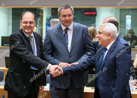 Stock Photo of German Agriculture Minister Christian Schmidt (L) ,Minister of Agriculture and the Environment of Slovenia Dejan Zidan (C) and Petre Daea, Romanian Minister of Agriculture and Rural Development during the European Agriculture and Fisheries Ministers Council at the European Council, in Brussels, Belgium, 19 February 2018.