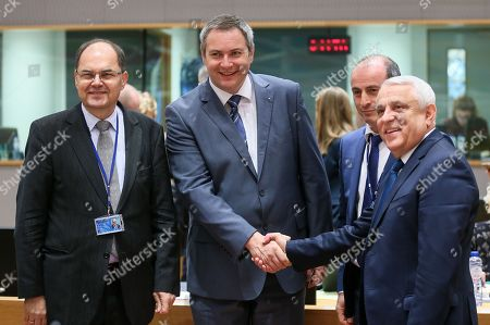 German Agriculture Minister Christian Schmidt (L) ,Minister of Agriculture and the Environment of Slovenia Dejan Zidan (C) and Petre Daea, Romanian Minister of Agriculture and Rural Development during the European Agriculture and Fisheries Ministers Council at the European Council, in Brussels, Belgium, 19 February 2018.
