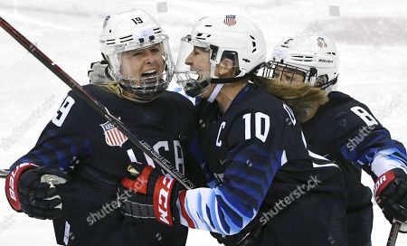 Gigi Marvin, Meghan Duggan and Emily Pfalzer of USA jubilates 1-0 goal against Finland during Ice-Hockey Women's Play-offs Semifinal match