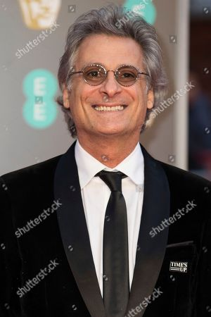 Stock Picture of Sound editor Mark Mangini poses for photographers upon arrival at the BAFTA Film Awards, in London