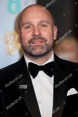 Johnny Harris poses for photographers upon arrival at the BAFTA Film Awards, in London