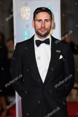 Stock Image of Edward Holcroft poses for photographers upon arrival at the BAFTA Film Awards, in London