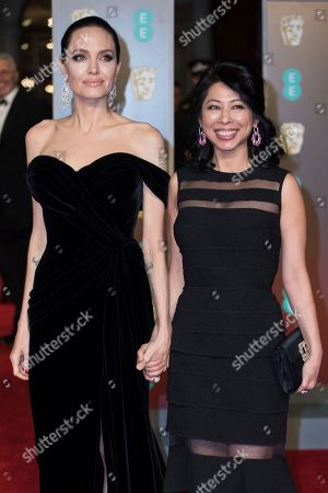 Angelina Jolie, Loung Ung. Angelina Jolie and Loung Ung pose for photographers upon arrival at the BAFTA Film Awards, in London