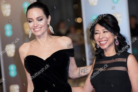 Stock Image of Angelina Jolie, Loung Ung. Angelina Jolie and Loung Ung pose for photographers upon arrival at the BAFTA Film Awards, in London