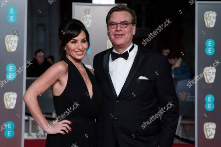 Molly Bloom, Aaron Sorkin. Molly Bloom and Aaron Sorkin pose for photographers upon arrival at the BAFTA Film Awards, in London
