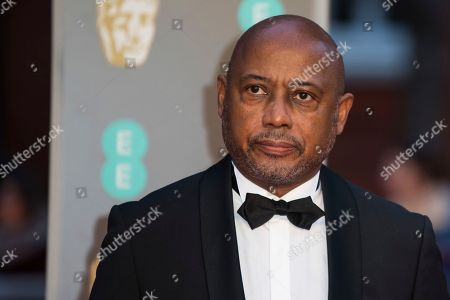 Raoul Peck poses for photographers upon arrival at the BAFTA Film Awards, in London