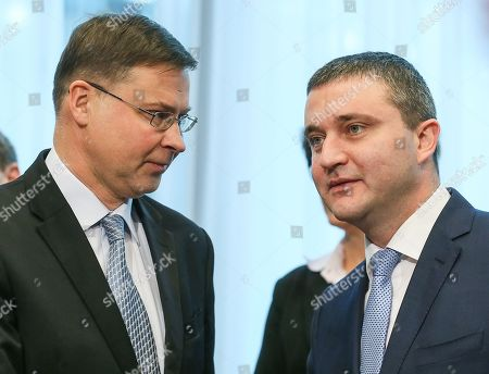 Bulgaria's Finance Minister Vladislav Goranov and European Commission Vice-President in charge of the euro and social dialogue Valdis Dombrovskis (L) during a macroeconomic dialogue on the sidelines of the Economic and Financial Affairs Council (ECOFIN) at the European Council, in Brussels, Belgium, 19 February 2018.