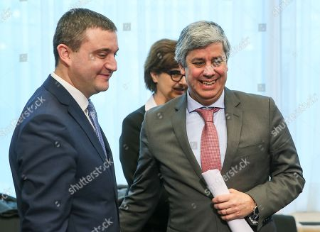 Bulgaria's Finance Minister Vladislav Goranov (L) and ThePresident of the Eurogroup , Portuguese Finance Minister Mario Centeno during a macroeconomic dialogue on the sidelines of the Economic and Financial Affairs Council (ECOFIN) at the European Council, in Brussels, Belgium, 19 February 2018.