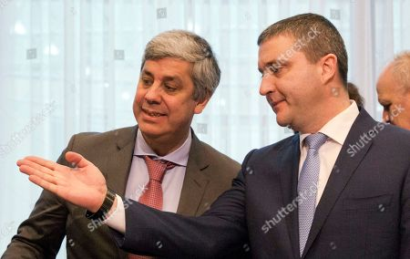 Eurogroup President Mario Centeno, left, speaks with Bulgarian Finance Minister Vladislav Goranov during a macroeconomic dialogue with social partners at the EU Council building in Brussels on